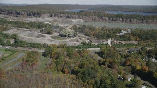AX91_156 - 4K stock footage aerial video of flying over fall foliage, approaching quarry, North Branford, Connecticut