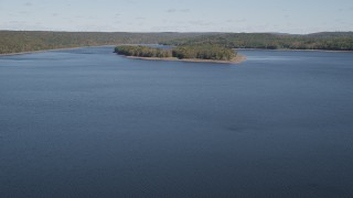 AX91_157 - 4K stock footage aerial video of flying over Lake Gallard, revealing small island in autumn, Lake Gallard, Connecticut