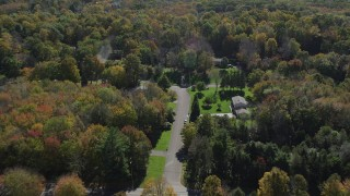 AX91_172 - 4K aerial stock footage video of flying over forest and homes in autumn, Guilford, Connecticut