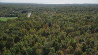 AX91_175 - 4K stock footage aerial video of panning and flying over lush forest, autumn, Guilford, Connecticut