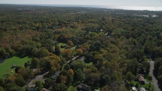 AX91_181 - 4K stock footage aerial video of approaching suburban homes and forests in autumn, Guilford, Connecticut