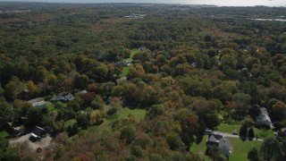 AX91_182 - 4K stock footage aerial video of flying over suburban neighborhoods and forests in autumn, Guilford, Connecticut