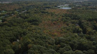 AX91_183 - 4K stock footage aerial video of approaching suburban neighborhoods from forests, autumn, Guilford, Connecticut