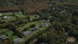 AX91_184 - 4K stock footage aerial video approach neighborhoods near forests in autumn, Guilford, Connecticut