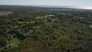 AX91_185 - 4K stock footage aerial video fly over forest, approach suburban neighborhoods in autumn, Guilford, Connecticut