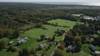 AX91_186 - 4K stock footage aerial video of flying over rural neighborhoods in autumn, Guilford, Connecticut