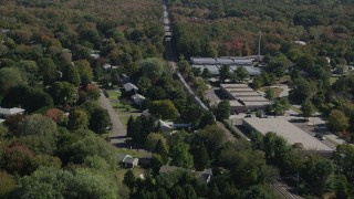 AX91_190 - 4K stock footage aerial video of tracking a passenger train through trees, autumn, Guilford, Connecticut