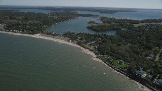 AX91_193 - 4K stock footage aerial video of approaching homes and beach near Hashamomuck Pond, Southold, New York