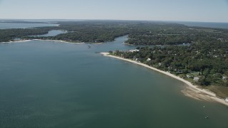 AX91_199 - 4K stock footage aerial video of flying by coastal neighborhoods, Southold, New York
