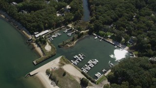 AX91_200 - 4K stock footage aerial video of flying over a small marina beside a beach in Southold, New York
