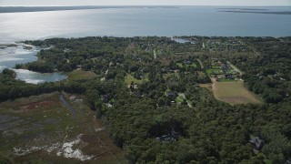 AX91_201 - 4K stock footage aerial video of approaching upscale homes on the coast in Southold, New York
