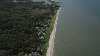 AX91_204 - 4K stock footage aerial video of flying over beachfront homes, revealing Wooley Pond, Southampton, New York