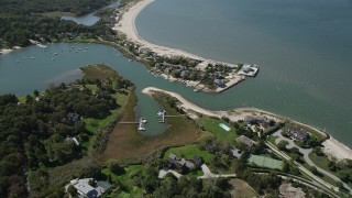 AX91_206 - 4K stock footage aerial video of flying by beachfront homes by Wooley Pond, Southampton, New York