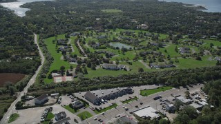 AX91_208 - 4K stock footage aerial video of approaching upscale homes and a pond in Southampton, New York