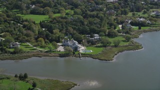 AX91_211 - 4K stock footage aerial video of flying by a waterfront mansion in Southampton, New York