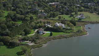 AX91_212 - 4K stock footage aerial video of passing by waterfront mansions, Southampton, New York