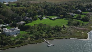AX91_213 - 4K stock footage aerial video of a view of upscale homes near the water, Southampton, New York