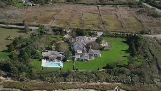 AX91_215 - 4K stock footage aerial video of approaching a mansion with a pool in Southampton, New York