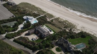 AX91_216 - 4K stock footage aerial video of flying over beachfront mansions in Southampton, New York