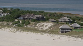 AX91_222 - 4K stock footage aerial video of passing by upscale beach homes, Southampton, New York