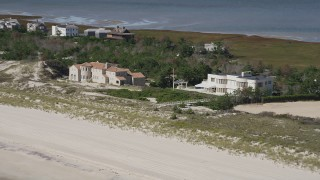 AX91_223 - 4K stock footage aerial video of flying by two beachfront mansions, Southampton, New York