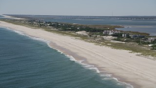 AX91_224 - 4K stock footage aerial video of flying by row of beachfront mansions, Southampton, New York