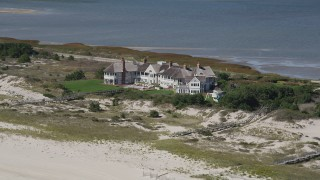 AX91_225 - 4K stock footage aerial video of flying by an isolated beachfront mansion, Southampton, New York