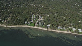 AX91_233 - 4K stock footage aerial video of approaching beachside homes with docks, Hampton Bays, New York