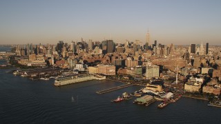 AX93_004 - 4K stock footage aerial video Flying by Chelsea Piers, Hudson River, New York, New York, sunset