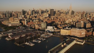 AX93_005 - 4K stock footage aerial video of Midtown Manhattan, from Chelsea Piers, New York, New York, sunset
