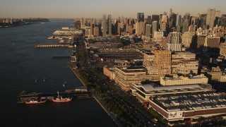 AX93_006 - 4K stock footage aerial video Approaching West Side Yard, Chelsea, New York, New York, sunset