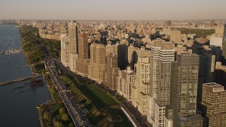 AX93_011 - 4K stock footage aerial video Flying by Henry Hudson Parkway, Upper West Side, New York, New York, sunset
