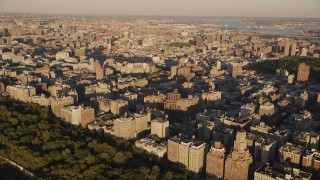 AX93_015 - 4K stock footage aerial video Flying by apartment buildings, Upper West Side, New York, New York, sunset