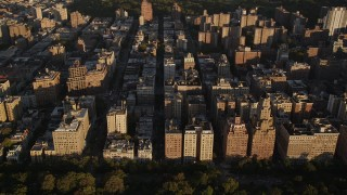 AX93_016 - 4K stock footage aerial video Flying by apartment buildings, Upper West Side, New York, New York, sunset