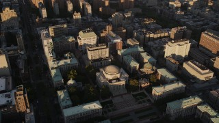 AX93_018 - 4K stock footage aerial video Flying by Columbia University, Morningside Heights, New York, New York, sunset
