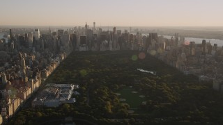 AX93_021 - 4K stock footage aerial video Jacqueline Kennedy Onassis Reservoir, Central Park, Midtown, New York, sunset