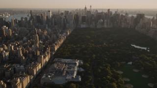 AX93_023 - 4K stock footage aerial video Approaching Metropolitan Museum of Art, tilt down, New York, New York, sunset