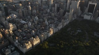 AX93_026 - 4K stock footage aerial video Flying by Upper East Side apartments, New York, New York, sunset