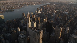 AX93_031 - 4K stock footage aerial video Flying by Chrysler Building, Midtown Manhattan, New York, New York, sunset