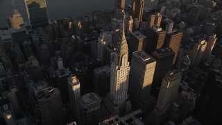 AX93_048 - 4K stock footage aerial video Flying by the Chrysler Building, Midtown Manhattan, New York, New York, sunset
