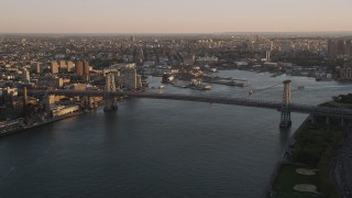 AX93_058 - 4K stock footage aerial video Approaching the Williamsburg Bridge, East River, New York, New York, sunset
