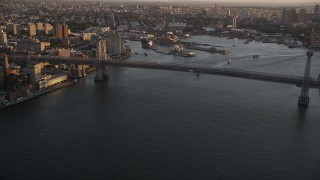 AX93_059 - 4K stock footage aerial video Approaching Williamsburg Bridge, East River, New York, New York, sunset