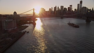 AX93_063 - 4K stock footage aerial video Brooklyn Bridge, Lower Manhattan, ascend Manhattan Bridge, New York, sunset