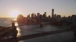 AX93_064 - 4K stock footage aerial video Manhattan Bridge, approach Brooklyn Bridge, Lower Manhattan, New York, sunset