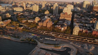 AX93_079 - 4K stock footage aerial video Panning left by traffic, Brooklyn Queens Freeway, Brooklyn, New York, New York, sunset