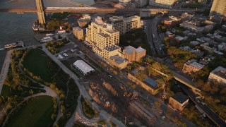 AX93_080 - 4K stock footage aerial video Panning away from Brooklyn, revealing Brooklyn Bridge, New York, New York, sunset