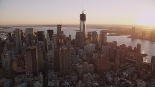 AX93_085 - 4K stock footage aerial video Flying by Lower Manhattan, New York, New York, sunset