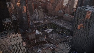 AX93_096 - 4K stock footage aerial video Flying by the World Trade Center Memorial, Lower Manhattan, New York, sunset