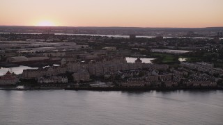 AX93_125 - 4K stock footage aerial video of Port Liberte condominiums, townhouses, Jersey City, New Jersey, sunset