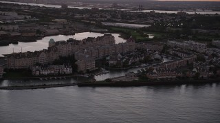 AX93_126 - 4K stock footage aerial video of Port Liberte condominiums, townhouses, Jersey City, New Jersey, twilight